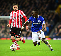 Lincoln City's Tom Pett vies for possession with Everton's Idrissa Gueye<br /> <br /> Photographer Andrew Vaughan/CameraSport<br /> <br /> Emirates FA Cup Third Round - Everton v Lincoln City - Saturday 5th January 2019 - Goodison Park - Liverpool<br />  <br /> World Copyright &copy; 2019 CameraSport. All rights reserved. 43 Linden Ave. Countesthorpe. Leicester. England. LE8 5PG - Tel: +44 (0) 116 277 4147 - admin@camerasport.com - www.camerasport.com