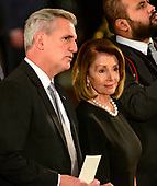 United States House Majority Leader Kevin McCarthy (Republican of California), left, and United States House Minority Leader Nancy Pelosi (Democrat of California), right, converse prior to the ceremony honoring former United States President George H.W. Bush, who will Lie in State in the Rotunda of the US Capitol on Monday, December 3, 2018.<br /> Credit: Ron Sachs / CNP<br /> (RESTRICTION: NO New York or New Jersey Newspapers or newspapers within a 75 mile radius of New York City)