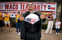 Political hip-hop artist David Saucedo (cq), who goes by the name Polatik (cq), shows off a God Bless America t-shirt after a performance during a Tea Party Express really at Indian Spring Park in Waco, Texas, Thursday, September 3, 2009. The Tea Party Express is heading to Washington, DC where it will hold a final rally against higher government spending, higher taxes, and President Obama's push to reform health care...PHOTOS/ MATT NAGER