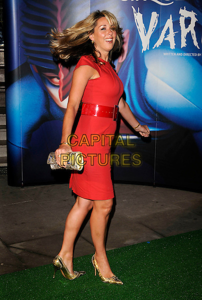 "CLAIRE SWEENEY.Attending the Cirque Du Soleil ""Varekai"" Premiere at the Royal Albert Hall, London, England, January 8th 2007..full length red Roland Mouret Moon dress belt Clare gold clutch bag shoes hair turning funny.CAP/CAN.©Can Nguyen/Capital Pictures"