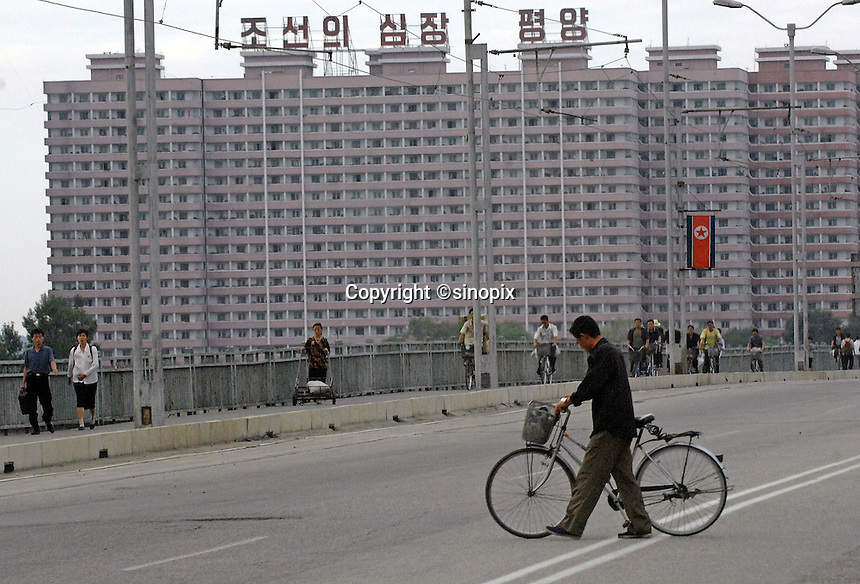 "Pyongyang cityscape. The DPRK (Democratic People's Republic of Korea) is the last great dictatorship where the people are bombarded with images of the ""Eternal President"" Kim Il-sung who died in 1994 and his son and current leader Kim Jong-il who are worshipped like a God."