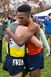 LOUISVILLE, KY - NOVEMBER 18: Justin Knight #615 of Syracuse University embraces Matthew Baxter #426 of Northern Arizona University during the Division I Men's Cross Country Championship held at E.P. Tom Sawyer Park on November 18, 2017 in Louisville, Kentucky. (Photo by Tim Nwachukwu/NCAA Photos via Getty Images)