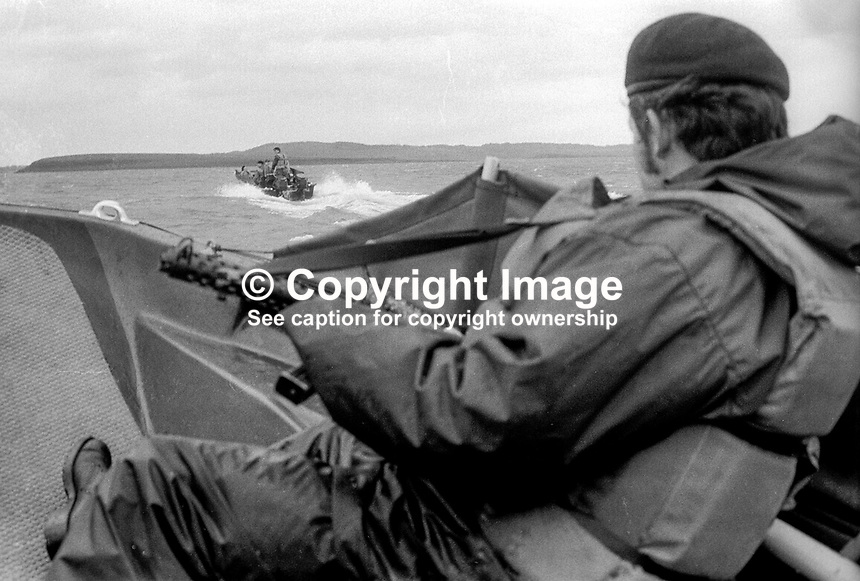 Ulster Defence Regiment members demonstrate the dories (sing. dory) which they will use on inland waterways to combat the smuggling of arms and personnel by para-military groups in N Ireland.  197205250293g<br />