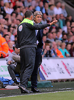 The fourth official speaks to Francesco Guidolin, Manager of Swansea City after the confusion with Iheanacho's goal during the Swansea City FC v Manchester City Premier League game at the Liberty Stadium, Swansea, Wales, UK, Sunday 15 May 2016