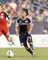 New England Revolution midfielder Lee Nguyen (24) on the attack. In a Major League Soccer (MLS) match, Toronto FC defeated New England Revolution, 1-0, at Gillette Stadium on July 14, 2012.