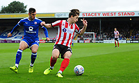 Lincoln City's Alex Woodyard shields the ball from Chesterfield's Diego De Girolamo<br /> <br /> Photographer Chris Vaughan/CameraSport<br /> <br /> The EFL Sky Bet League Two - Lincoln City v Chesterfield - Saturday 7th October 2017 - Sincil Bank - Lincoln<br /> <br /> World Copyright &copy; 2017 CameraSport. All rights reserved. 43 Linden Ave. Countesthorpe. Leicester. England. LE8 5PG - Tel: +44 (0) 116 277 4147 - admin@camerasport.com - www.camerasport.com
