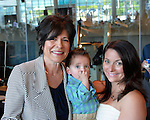 L-R, RITA KESTENBAUM (D-Bellmore), running for Hempstead Town Supervisor, poses with her grandson JUSTIN KESTENBAUM, 14-months-old, and her daughter-in-law NATALIE KESTENBAUM, at the Nassau County Democrats nominating convention. The party's executive committee nominated 55 candidates, including R. Kestenbaum, for political and judicial races at the convention, which was held at the Cradle of Aviation in Garden City, Long Island.