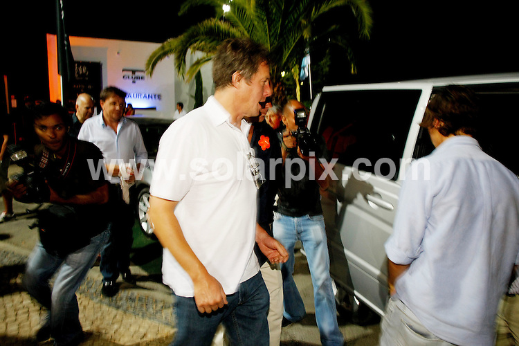 **ALL ROUND PICTURES FROM SOLARPIX.COM**.**WORLDWIDE SYNDICATION RIGHTS EXCEPT FOR PORTUGAL AND SPAIN** **NO PUBLICATION IN PORTUGAL OR SPAIN**.Hollywood  English actor Hugh Grant leaving the T Club in the Algarve, Portugal....JOB REF: 9719     NPP     DATE:08.08.09.**MUST CREDIT SOLARPIX.COM OR DOUBLE FEE WILL BE CHARGED**.***ONLINE USAGE FEE GBP 50.00 PER PICTURE - NOTIFICATION OF USAGE TO PHOTO @ SOLARPIX.COM**.**CALL SOLARPIX : +34 952 811 768 or LOW RATE FROM UK 0844 617 7637**