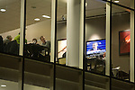 Manchester United 4 Derby County 1, 12/01/2009. Old Trafford, League Cup semi-final, second leg. Guests are oblivious to the inauguration of US President Barak Obama on a television screen in one of the corporate hospitality facilities in the main stand at Old Trafford before the Carling Cup semi-final second leg clash between Manchester United and Derby County. The visitors led one-nil from the first leg, however, United overturned this with a 4-2 victory to reach the final at Wembley. Photo by Colin McPherson.