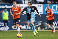 Michael Harriman of Wycombe Wanderers (centre) during the Sky Bet League 2 match between Luton Town and Wycombe Wanderers at Kenilworth Road, Luton, England on 26 December 2015. Photo by David Horn.