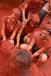 "People celebrates the ""Tomatina"" on August 31th, 2005 in Bunyol, Valencia, Spain. Approximately 45,000 people pelted each other with around 100.000 kilograms of tomatoes. The ""Tomatina"" is known as the world's largest tomato battle. (Ander Gillenea / Bostok Photo)"