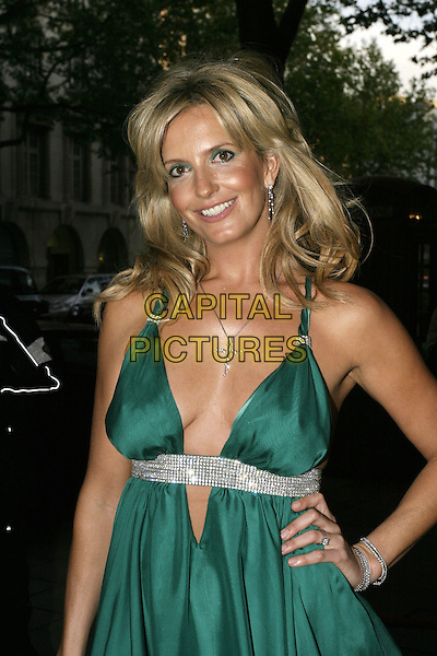 "PENNY LANCASTER .Judges the final of ""Specsavers' Sexiest Specs Wearer Competition 2005"", Waldorf Hilton Hotel, Aldwych, London, May 12th 2005..half length Kyri designed green satin dress crystals diamante babydoll plunging neckline low cut silver cross necklace halterneck.Ref: AH.www.capitalpictures.com.sales@capitalpictures.com.©Adam Houghton/Capital Pictures."