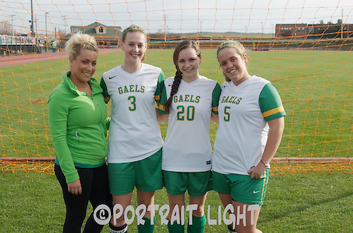 CHS girls soccer coach Jillian Osvold with senior captains (from left) Jillian Hazel, Laura Hazel and Kelli Peete.