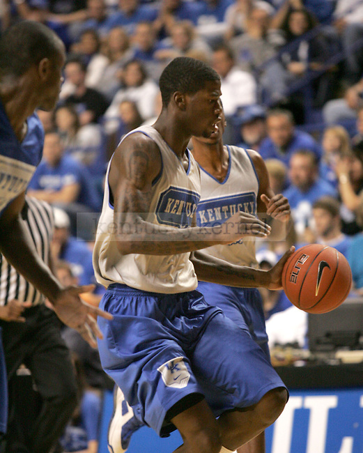 DeAndre Liggins dribbles down the court during the first period of the Blue and White scrimmage at Rupp Arena Wednesday night..Photo by Zach Brake | Staff