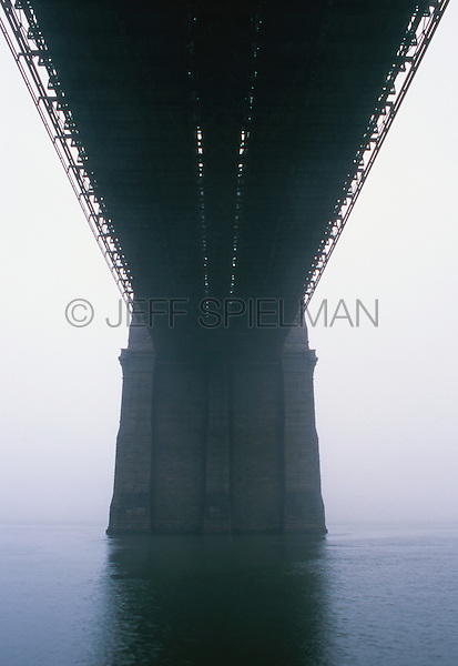 AVAILABLE FROM JEFF AS A FINE ART PRINT.<br /> <br /> AVAILABLE FROM JEFF FOR COMMERCIAL AND EDITORIAL LICENSING.<br /> <br /> Brooklyn Bridge Support Structure and East River in the Fog, Lower Manhattan, New York City, New York State, USA