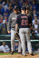 Cleveland Indians manager Terry Francona talks with Mike Napoli (26) and Yan Gomes (10) while making a pitching change in the eighth inning during Game 3 of the Major League Baseball World Series against the Chicago Cubs on October 28, 2016 at Wrigley Field in Chicago, Illinois.  (Mike Janes/Four Seam Images)