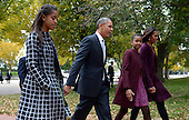 United States President Barack Obama walks with his wife Michelle Obama (R) and two daughters Malia Obama (L) and Sasha Obama (2R) across Lafayette Park to St John's Church to attend service in Washington, DC, USA, 27 October 2013.<br /> Credit: Shawn Thew / Pool via CNP