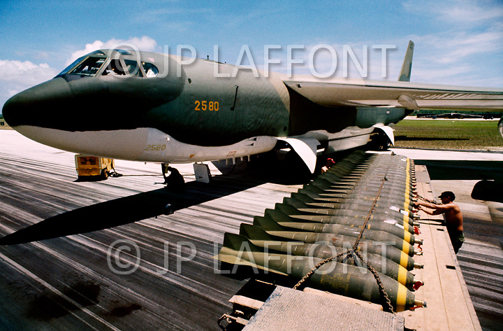 Guam Island. June 1972.<br /> A member of US Airforce loads bombs onto B-52 plane in preperation for bombing missions over Vietnam during Operation Arc Light -  Vietnam War. The Andersen Air Force Base on Guam Island from where the B-52 Stratofortress planes take off for Vietnam. 700lb (pound) bombs are loaded into the hold of a B-52.