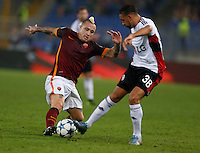 AS Roma's Radja Nainggolan and Leverkusen's Karim Bellarabi  during the Champions League Group E soccer match between As Roma and  Bayer Leverkusen at the Olympic Stadium in Rome, November 04 2015