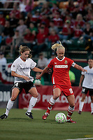 Meghan Klingenberg (4) of the magicJack and Caroline Seger (9) of the Western New York Flash battle for the ball during second half action. The Western New York Flash defeated the magicJack 3-0 in Women's Professional Soccer (WPS) at Sahlen's Stadium in Rochester, NY May 22, 2011.