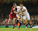 Mike Brown of England tackled by George North of Wales - RBS 6Nations 2015 - Wales  vs England - Millennium Stadium - Cardiff - Wales - 6th February 2015 - Picture Simon Bellis/Sportimage