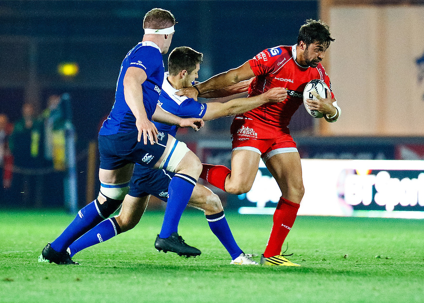 Scarlets' Gareth Owen under pressure from Leinster's Ross Byrne<br /> <br /> Photographer Simon King/CameraSport<br /> <br /> Rugby Union - Guinness PRO12 - Scarlets v Leinster - Friday 16th October 2015 - The Liberty Stadium - Swansea<br /> <br /> &copy; CameraSport - 43 Linden Ave. Countesthorpe. Leicester. England. LE8 5PG - Tel: +44 (0) 116 277 4147 - admin@camerasport.com - www.camerasport.com