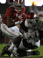 Arkansas Democrat-Gazette/BENJAMIN KRAIN --10/10/15--<br /> Alabama running back Kenyan Drake (17) is tackled by Arkansas defenders during the third quarter of the Razorbacks 27-14 loss.