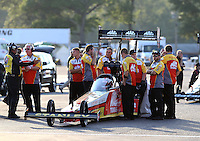Aug 15, 2014; Brainerd, MN, USA; Crew members surround the car of NHRA top fuel driver Doug Kalitta during qualifying for the Lucas Oil Nationals at Brainerd International Raceway. Mandatory Credit: Mark J. Rebilas-USA TODAY Sports