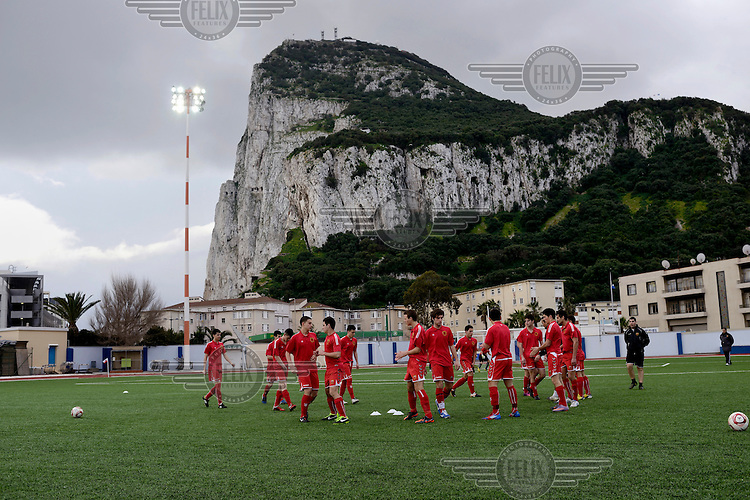 Players from the Gibraltarian under-17 national team  train at the Victoria Stadium prior to a match against Northern Ireland played in March 2013. Although the United Nations doesn't recognise Gibraltar as an independent country, UEFA has recognised it and has granted the British Overseas Territory full UEFA membership.