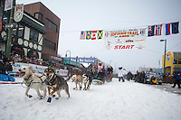Jason Mackey runs down the chute on 4th avenue during ceremonial start of the Iditarod sled dog race Anchorage Saturday, March 2, 2013. ..Photo (C) Jeff Schultz/IditarodPhotos.com  Do not reproduce without permission