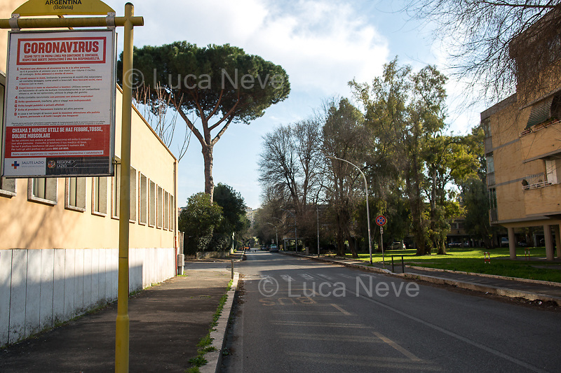 Rome, 18/03/2020. Rome's Olympic Village district under the Italian Government lockdown for the Outbreak of the Coronavirus SARS-CoV-2 - COVID-19. On the 22nd March, the Italian PM Giuseppe Conte signed a new Decree Law which suspends non-essential industry productions and contains the list of allowed working activities, which includes Pharmaceutical & food Industry, oil & gas extraction, clothes & fabric, tobacco, transports, postal & banking services (timetables & number of agencies reduced), delivery, security, hotels, communication & info services, architecture & engineer, IT manufacturers & shops, call centers, domestic personnel (1.).<br /> Updates: Italy: 22.03.20, 6:00PM: 46.638 positive cases; 7.024 recovered; 5.476 died.<br /> <br /> The Rome's Olympic Village (1957-1960) was designed by: V. Cafiero, A. Libera, A. Luccichenti, V. Monaco, L. Moretti. «Built to host the approximately 8,000 athletes involved in the 1960 Olympic Games, Rome's Olympic Village is a residential complex located between Via Flaminia, the slopes of Villa Glori and Monti Parioli. It was converted into public housing [6500 inhabitants, ndr] at the end of the sporting event. The intervention is an example of organic settlement, characterized by a strong formal homogeneity, consistent with the Modern Movement's principles of urbanism. The different architectural structures are made uniform by the use of some common elements: the pilotis, ribbon windows, concrete stringcourses, and yellow brick curtain covering. At the center of the neighborhood, the Corso Francia viaduct - a road bridge about one kilometer long - was built by Pier Luigi Nervi […]» (2.).<br /> <br /> Info about COVID-19 in Italy: http://bit.do/fzRVu (ITA) - http://bit.do/fzRV5 (ENG)<br /> 1. March 22nd Decree Law http://bit.do/fFwJn (ITA)<br /> 2. (Atlantearchitetture.beniculturali.it MiBACT, ITA - ENG) http://bit.do/fFw3H<br /> 12.03.20 Rome's Lockdown for the Outbreak of the Coronavirus SARS-CoV-2 - COVID-19 http://bit