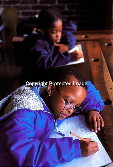 dieduca00147 Education, School: Unidentified children studying in a class room on July 12, 2002 at a Catholic school in Soweto, a black township outside Johannesburg, South Africa. Soweto is the largest township in the country and itÕs estimated that about 3-4 million people resides there..©Per-Anders Pettersson / iAfrika Photos...