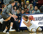 RAPID CITY, SD: DECEMBER 1:  Katie Messler #40 of Black Hills State tries to save the ball as Marissa Hirchert #20 of South Dakota Mines gives chase during their Rocky Mountain Athletic Conference women's basketball game Saturday evening at the King Center Rapid City, S.D.  (Photo by Richard Carlson/dakotapress.org)