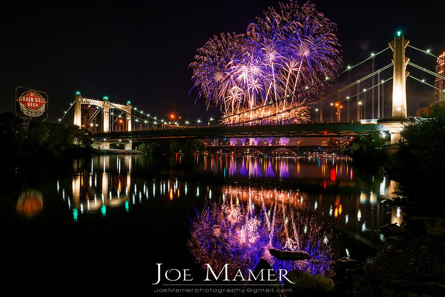 Minneapolis Aquatennial fireworks over the Fr. Hennepin Bridge and Mississippi River in Minneapolis, Minnesota.