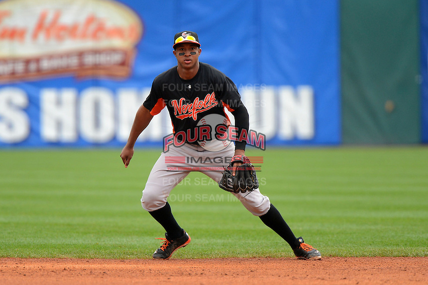 Norfolk Tides shortstop Jonathan Schoop #46 during a game against the Buffalo Bisons on May 9, 2013 at Coca-Cola Field in Buffalo, New York.  Norfolk defeated Buffalo 7-1.  (Mike Janes/Four Seam Images)