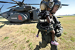 A girl evacuated from Jacmel, on Haiti's southern coast, arrives in Port-au-Prince on January 22 aboard a U.S. Navy Blackhawk helicopter and is escorted off the aircraft by a U.S. sailor. Hundreds of thousands of Haitians remain homeless and hungry in the wake of the country's devastating January 12 earthquake.