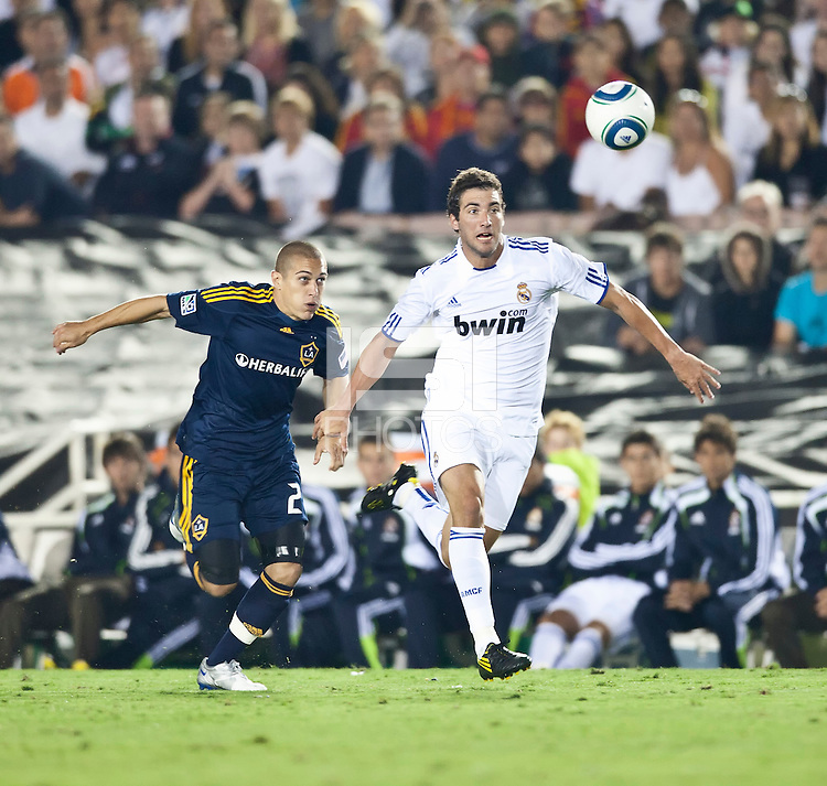 Galaxy forward Bryan Jordan (27) battles Real forward Gonzalo Higuain (20) during the second half of the friendly game between LA Galaxy and Real Madrid at the Rose Bowl in Pasadena, CA, on August 7, 2010. LA Galaxy 2, Real Madrid 3.