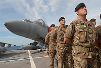 "- Italian soldiers in navigation for Lebanon on the Garibaldi aircraft carrier for participate to U.N. peace mission; troops of the navy infantry regiment S.Marco, vertical take-off aircraft AV-8B ""Harrier""....- militari italiani in navigazione per il Libano a bordo della portaerei Garibaldi per partecipare alla missione di pace dell'ONU; truppe del reggimento fanteria di marina S.Marco, vertical take-off aircraft AV-8B ""Harrier"""