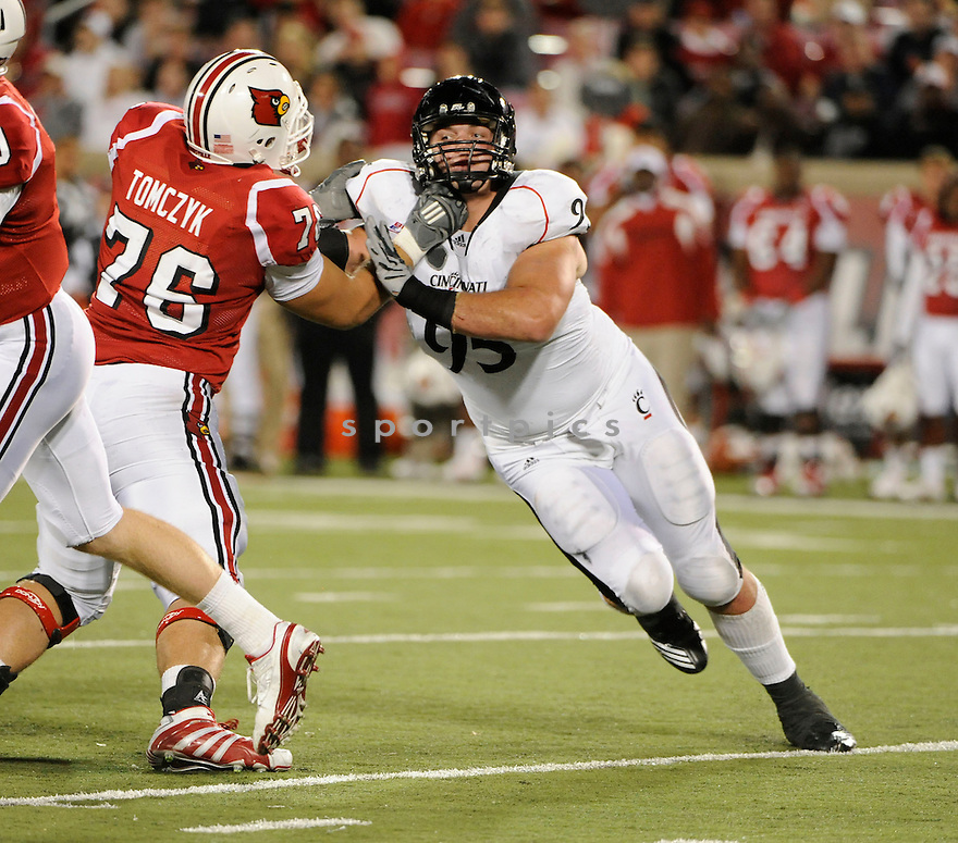DEREK WOLFE, of the Cincinnati BearCats in action during the BearCats game against Louisville Cardinals  on October 15, 2010 at Papa John's Cardinal Stadium in Louisville, Kentuck...The Cincinnati BearCats  beat the Louisville Cardinals 35-27