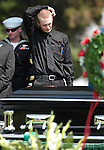 Dillon Blunk stands graveside following a memorial service for his brother Jonathan Blunk, in Reno, Nev. on Friday morning, Aug. 3, 2012. Blunk was killed in the July 20 movie theater shooting in Colorado. (AP Photo/Cathleen Allison)