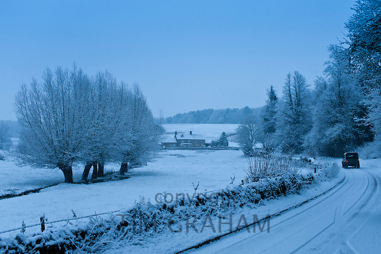 Traditional snow scene in a typical Cotswolds village, Swinbrook, Oxfordshire, United Kingdom