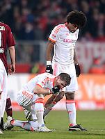 FUSSBALL   1. BUNDESLIGA  SAISON 2012/2013   12. Spieltag 1. FC Nuernberg - FC Bayern Muenchen      17.11.2012 Bastian Schweinsteiger und Dante (v. li., FC Bayern Muenchen)