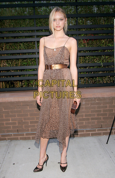 "GEMMA WARD.at the ""Daily Mini"" Launch Party, New York, NY, USA,.06 June 2006..full length brown print dress bronze belt metallic waist shoes clutch bag.Ref: ADM/JL.www.capitalpictures.com.sales@capitalpictures.com.©Jackson Lee/AdMedia/Capital Pictures."