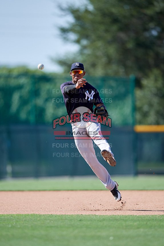 GCL Yankees West shortstop Roberto Chirinos (32) throws to first base during a game against the GCL Pirates on August 2, 2018 at Pirate City Complex in Bradenton, Florida.  GCL Pirates defeated GCL Yankees West 6-2.  (Mike Janes/Four Seam Images)