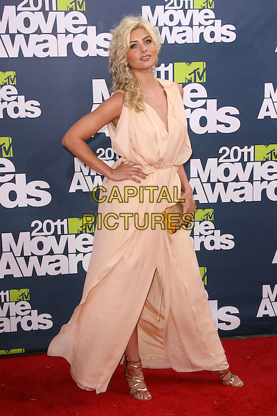 Alyson Michalka.The 2011 MTV Movie Awards held at Universal Studios Gibson Amphitheatre, Universal City, California, USA..June 5th, 2011.full length beige nude long maxi sleeveless dress hand on hip clutch bag aly .CAP/ADM.©AdMedia/Capital Pictures.