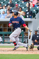 Mookie Betts (12) of the Pawtucket Red Sox follows through on his swing against the Charlotte Knights at BB&T Ballpark on August 10, 2014 in Charlotte, North Carolina.  The Red Sox defeated the Knights  6-4.  (Brian Westerholt/Four Seam Images)