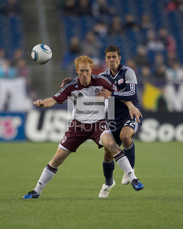 Colorado Rapids midfielder Jeff Larentowicz (4) and New England Revolution forward Benny Feilhaber (22) battle for the ball. In a Major League Soccer (MLS) match, the New England Revolution tied the Colorado Rapids, 0-0, at Gillette Stadium on May 7, 2011.