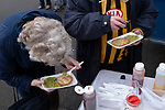 Atherton Collieries 1, Boston United 0, 23/11/19. Alder House, FA Trophy, third qualifying round. Two visiting supporters eating a pie and mushy peas before Atherton Collieries played Boston United in the FA Trophy third qualifying round at the Skuna Stadium. The home club were formed in 1916 and having secured three promotions in five season played in the Northern Premier League premier division. This was the furthest they had progressed in the FA Trophy and defeated their rivals from the National League North by 1-0, Mike Brewster scoring a late winner watched by a crowd of 303 spectators. Photo by Colin McPherson.
