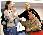 Gary Wilcox/staff.... 11/02/06...(left to Right) In November Erin Mathis and Caleb Mathis welcome Mickey Rooney and his wife; Jan,  made a visit to the USO Mayport, Rooney and wife are in Jacksonville  to  join the cast of the Greater Jacksonville Area USO 65th Anniversary Gala 'Thanks for the Memories'' this Saturday at 7:30 p.m. at the Times-Union Performing Arts Center's Moran Theatre.Ê