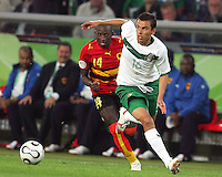 Mendonca (14) of Angola tries to catch Mario Mendez (16) of Mexico. Mexico and Angola played to a 0-0 tie in their FIFA World Cup Group D match at FIFA World Cup Stadium, Hanover, Germany, June 16, 2006.